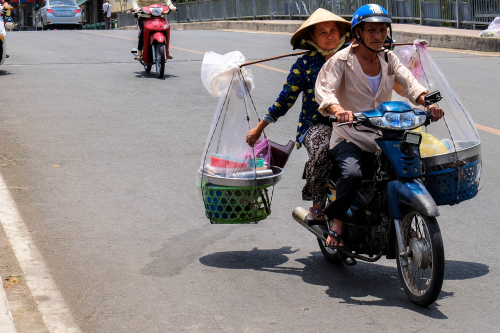 Man and woman on the scooter in Vietnam - Vietnam Photo Story