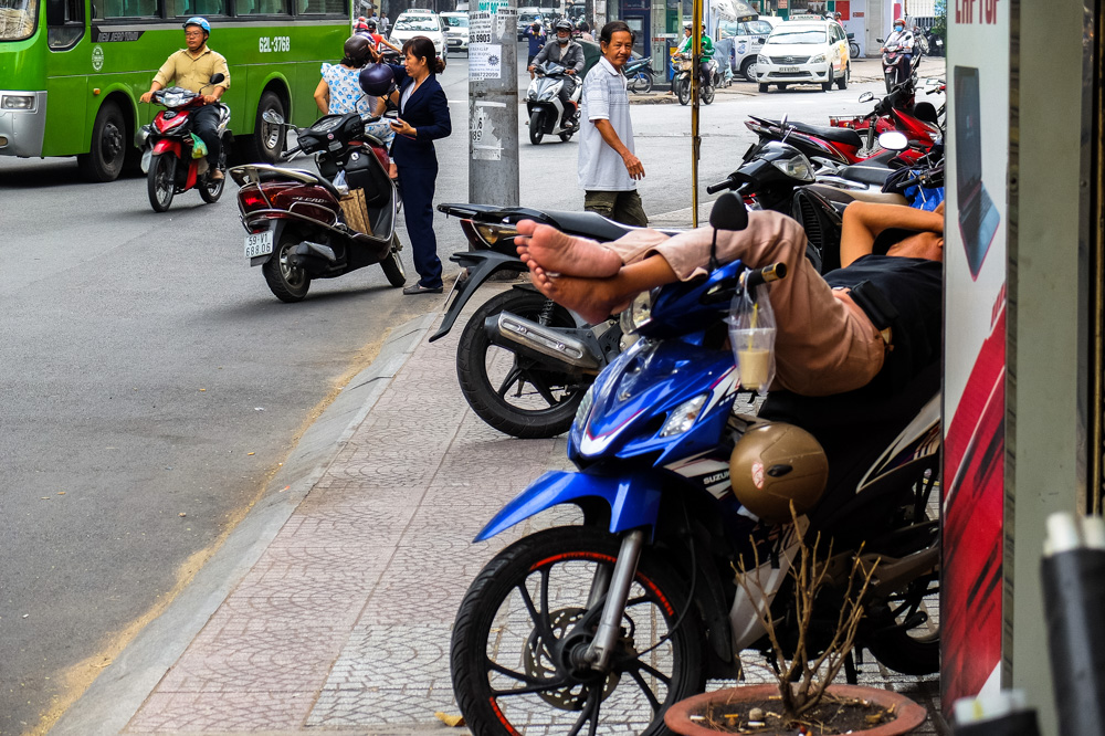 Man sleeping on a scooter in Ho Chi Minh City - Vietnam Photo Story