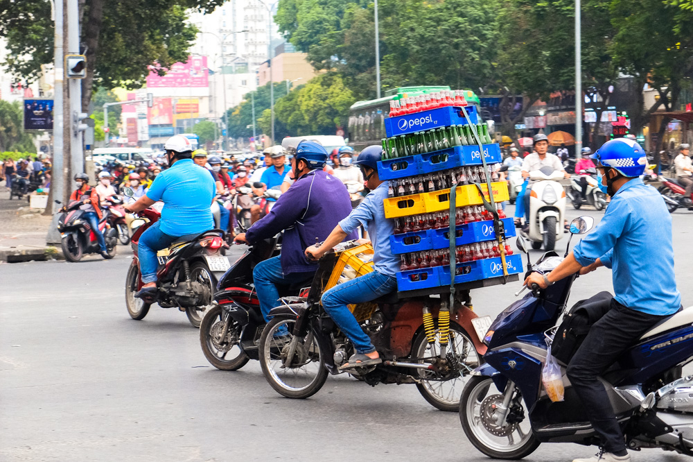 Man transporting boxes of coke on a scooter in Ho Chi Minh City - Vietnam Photo Story