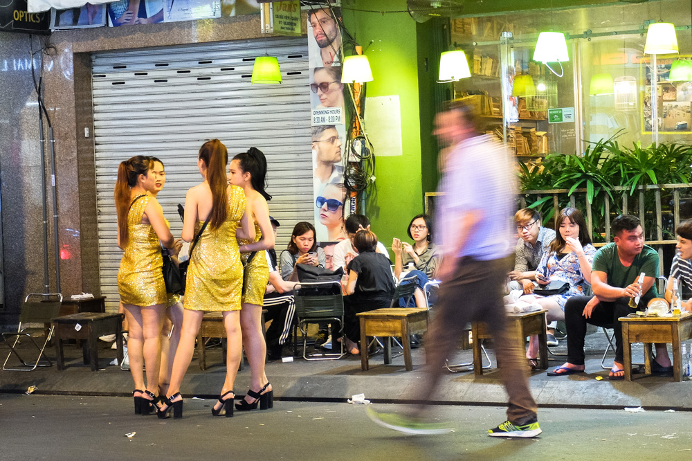 People sitting outside the restaurant in Ho Chi Minh City - Vietnam Photo Story