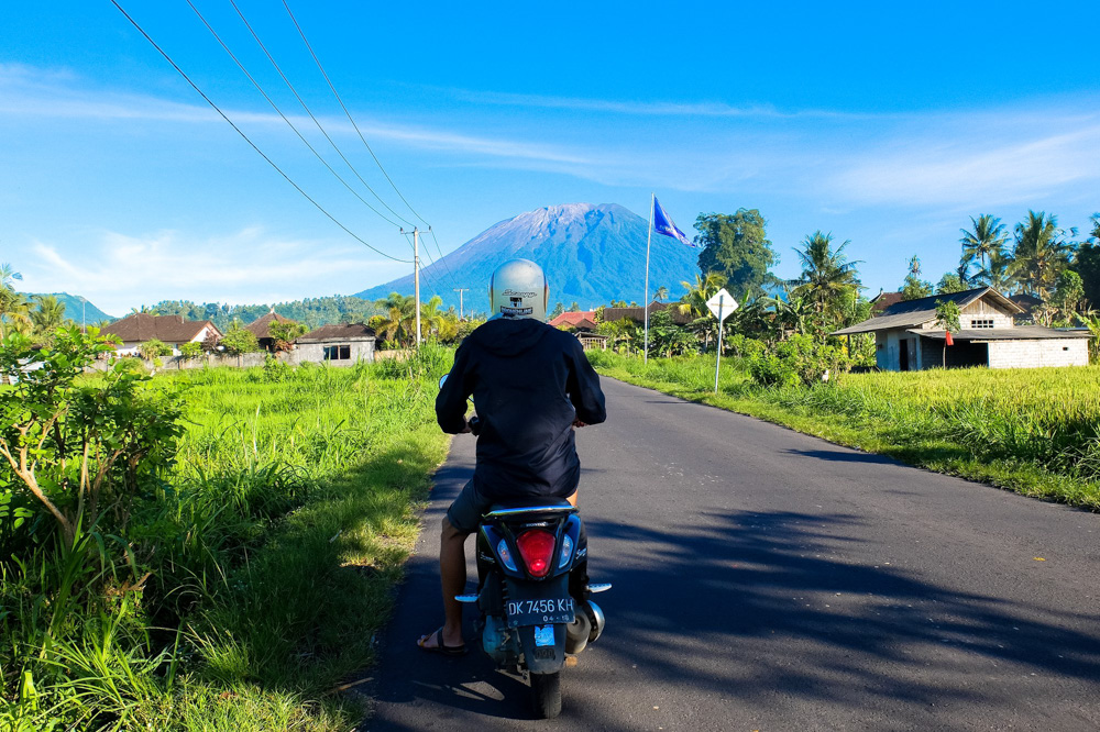 Road with a view of mount Agung in Bali - Riding a Scooter in Bali