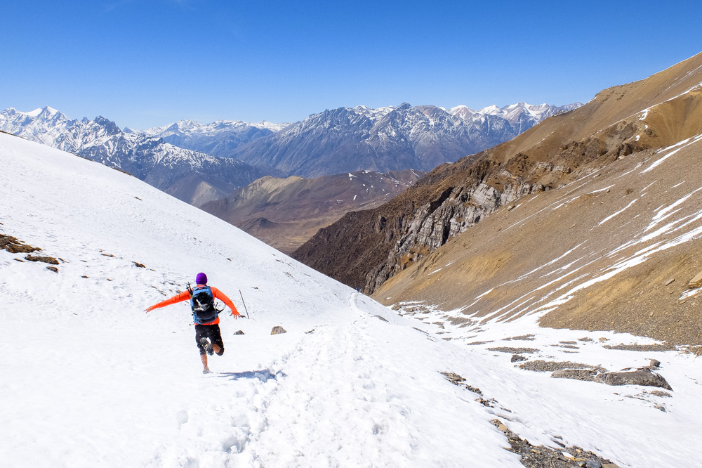 Running down the hill from Thorung La Pass - Annapurna Circuit Photos