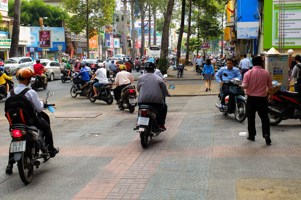 Scooters driving on the sidewalk in Ho Chi Minh City - Vietnam Photo Story