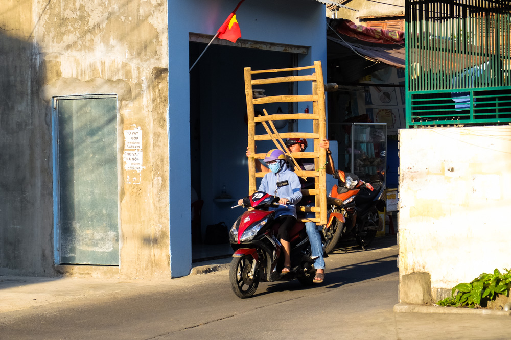 Men transporting a table on a scooter - Vietnam Photo Story