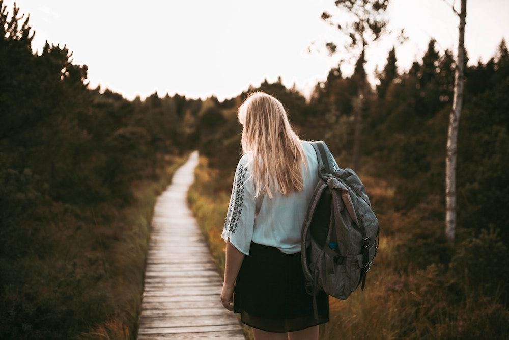 A woman with a backpack - Best Anti Theft Backpack