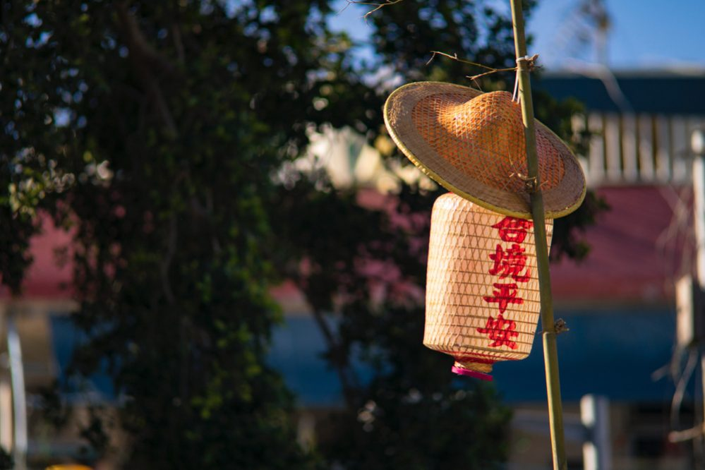A straw hat and a Chinese lamp