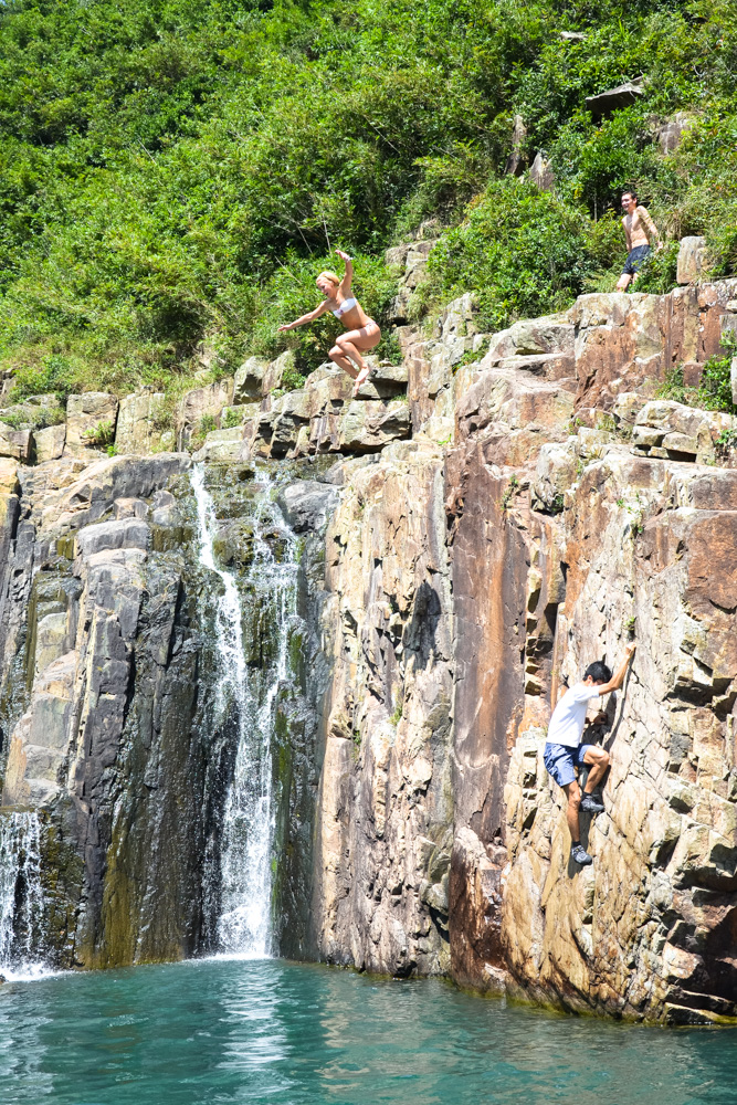 Jumping from the top of waterfall in Hong Kong - Best Things to Do in Hong Kong