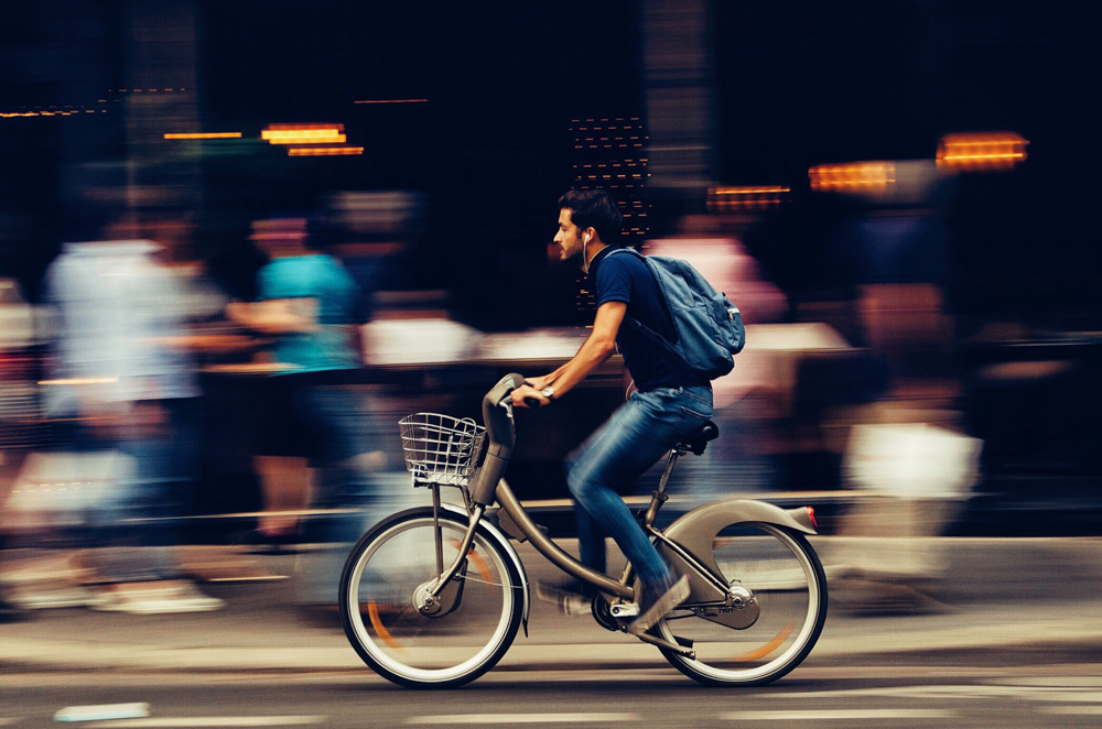 Man riding a bicycle - Best Things to Do in Hong Kong