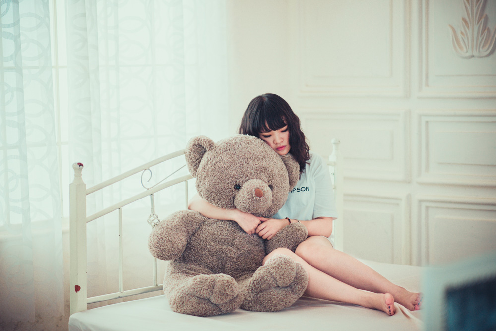 Girl with a big teddy bear - Best Things to Do in Penang, Malaysia
