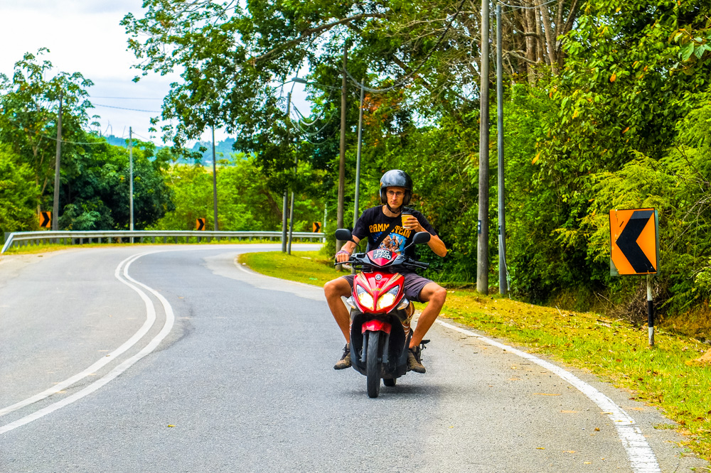 Kaspars driving a scooter - Best Things to Do in Penang, Malaysia