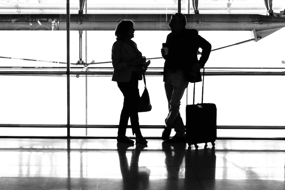 Man and Woman in Airport - Best Luggage Sets