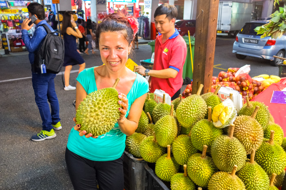 Woman holding a durian - Best Things to Do in Penang, Malaysia