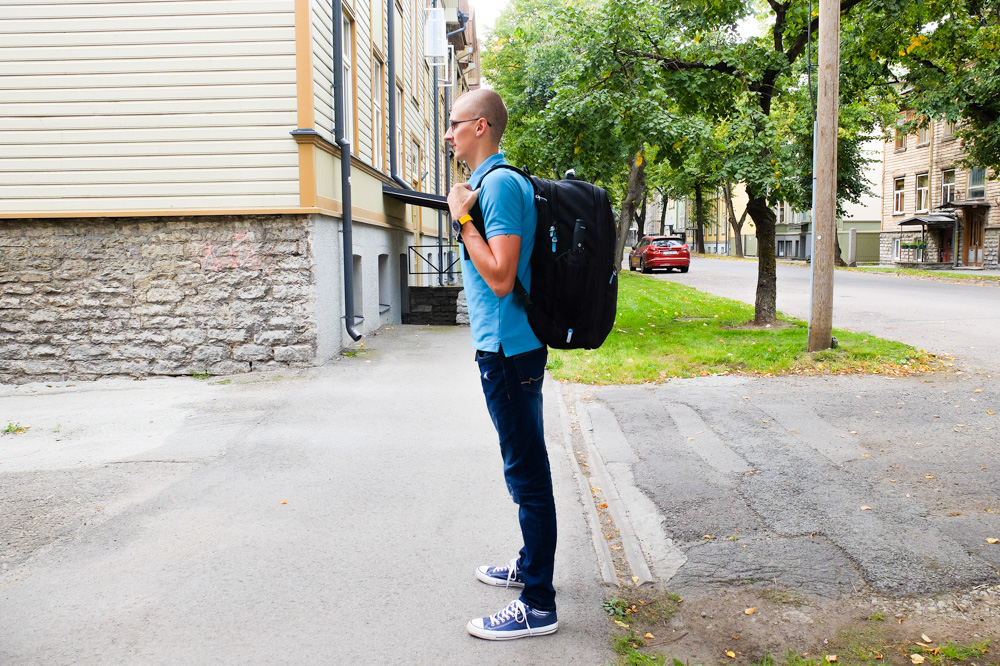 Kaspars wearing Standard's carry-on backpack - from the left side