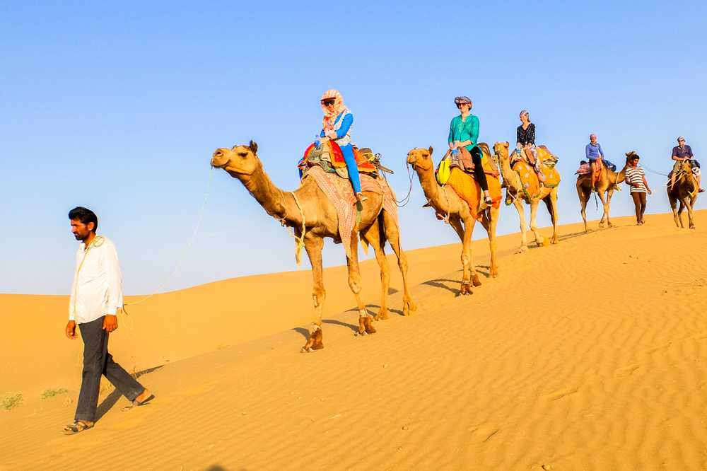 People on camels in the desert near Jaisalmer - Our Jaisalmer Desert Safari Experience