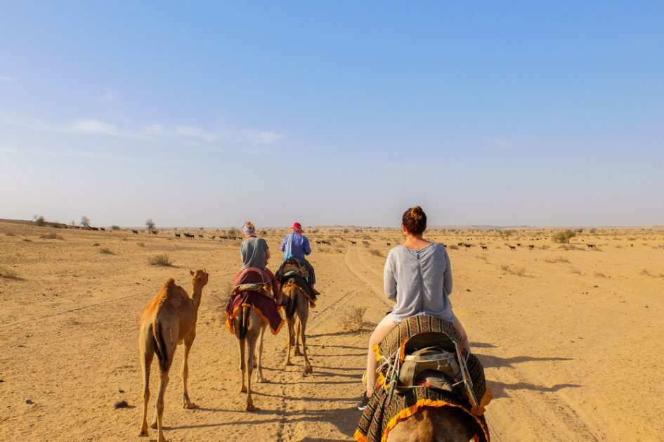 Riding camels in the plains near Jaisalmer, India