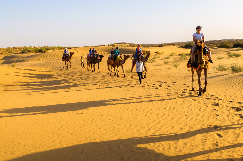 Riding camels on sand dunes in India - Our Jaisalmer Desert Safari Experience