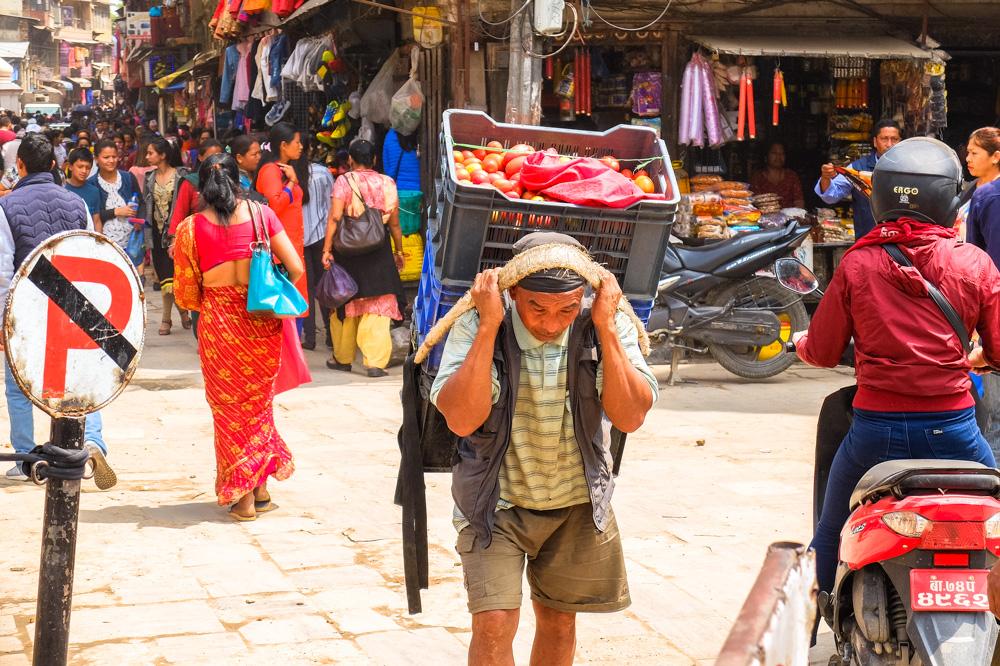 A man carrying a box - Thamel, Kathmandu