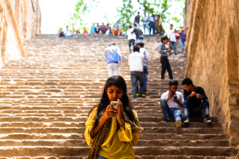 Girl using a phone - Delhi, India - How to get a SIM card in India