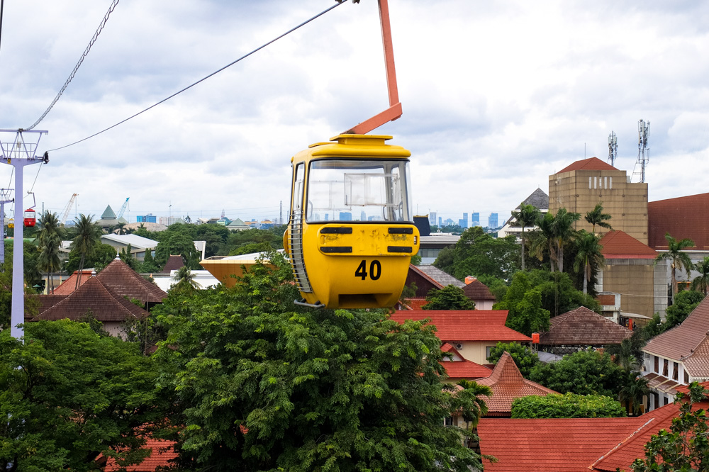 Riding a cable car in Taman Mini Indonesia, Jakarta