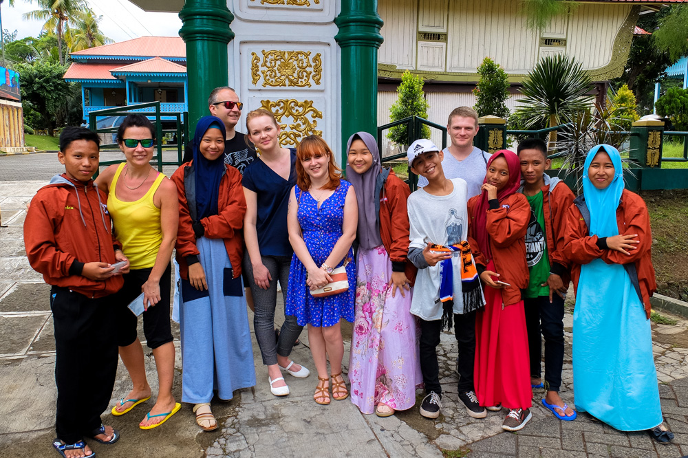 Taking a photo with local youngsters in Jakarta, Indonesia