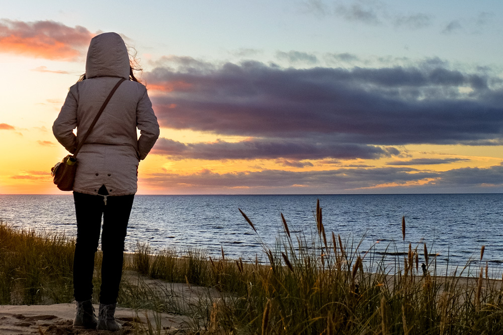Girl standing on the beach in Latvia