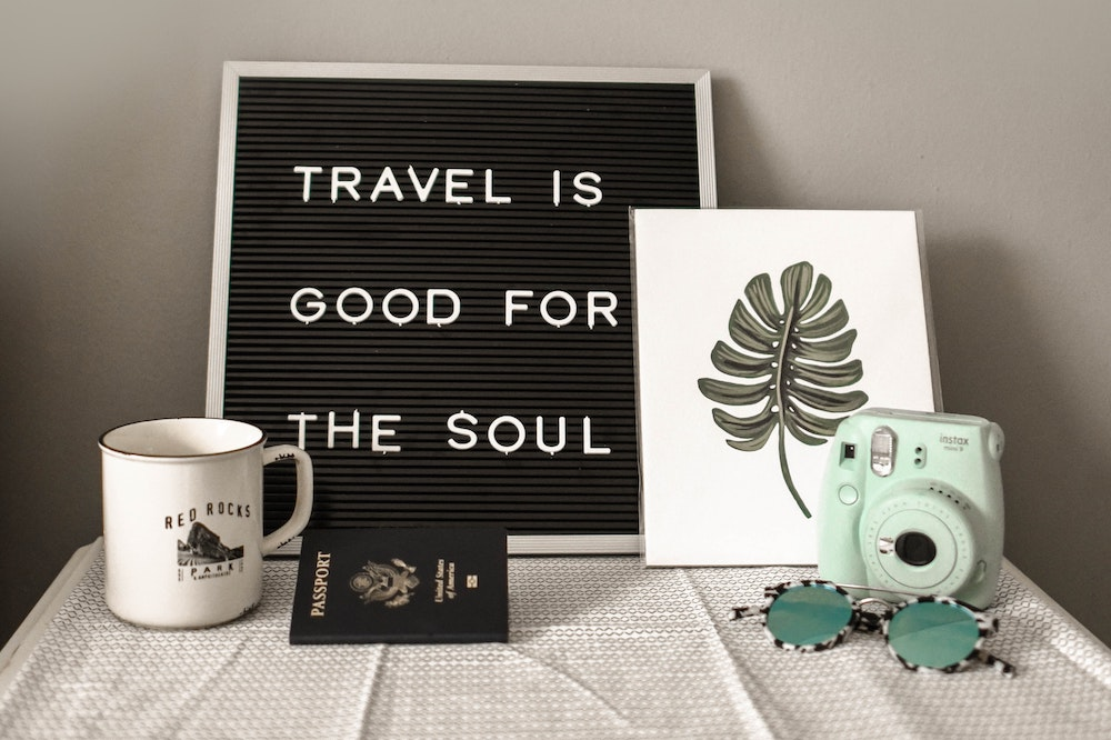 A mug and a passport - Holiday packing list