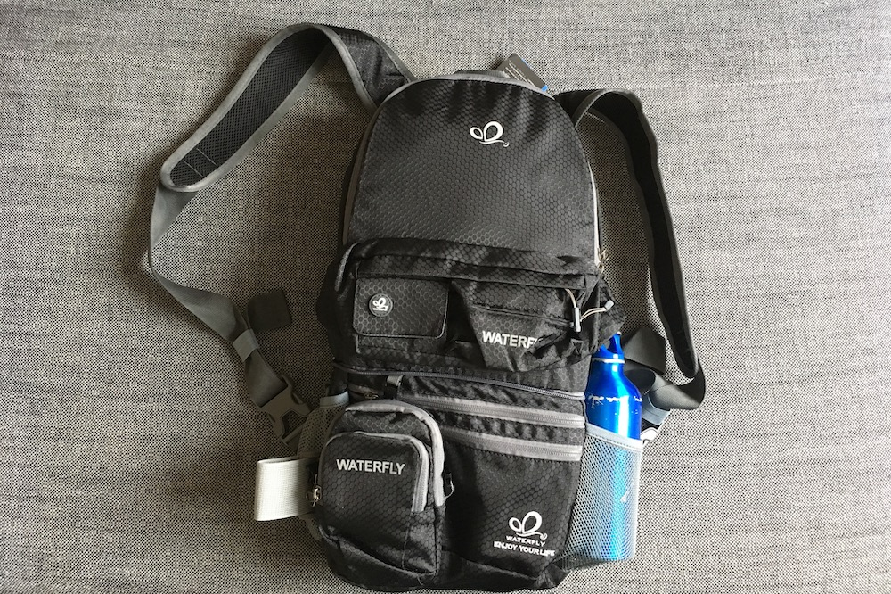 The WaterFly Smart Backpack and a Water Bottle